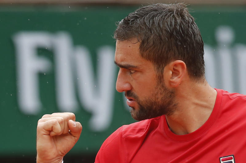 Croatia's Marin Cilic clenches his fist after scoring a point against Australia's James Duckworth during their first round match of the French Open tennis tournament at the Roland Garros stadium in Paris France Tuesday