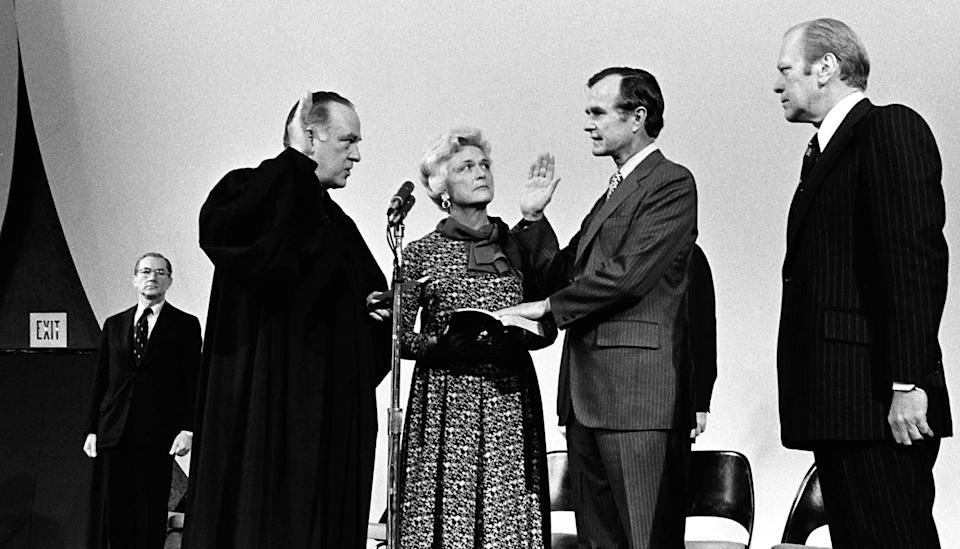 President Gerald Ford (far right) and Barbara Bush watch as Justice Potter Stewart swears in George H.W. Bush as director of the CIA at the agency's Langley, Virginia, headquarters on Jan. 26, 1976.