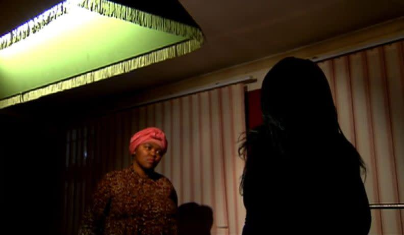 The mother, whose silhouette can be seen in this image from a SABC News interview, has chosen to remain anonymous to protect her son's privacy. (Photo: SABC News)