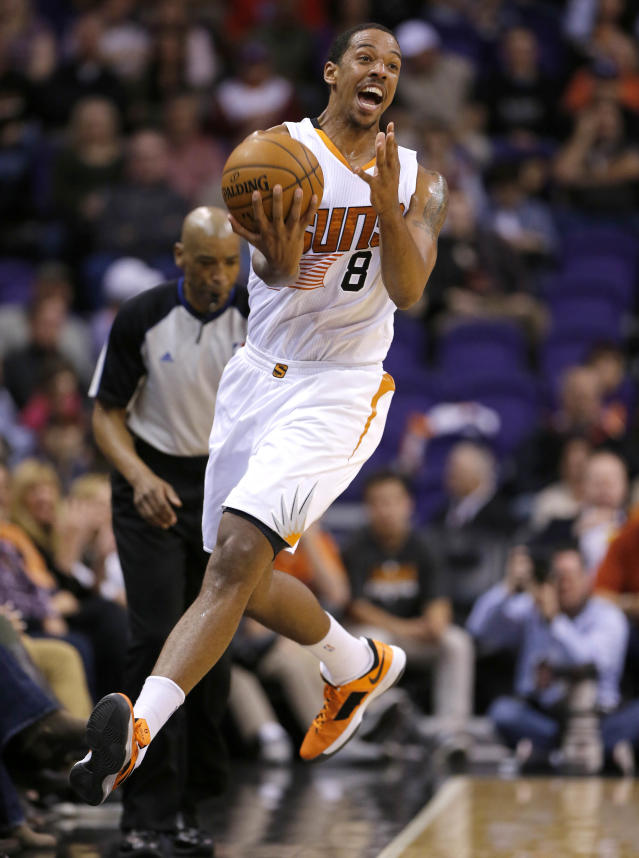 Phoenix Suns' Channing Frye tries to save a loose ball during the first half of an NBA basketball game against the Memphis Grizzlies, Thursday, Jan. 2, 2014, in Phoenix. (AP Photo/Matt York)