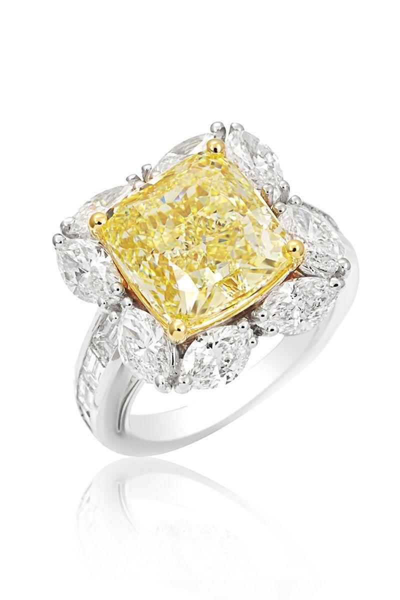 "<p><em><strong>PICCHIOTTI</strong> Engagement Ring with a cushion cut fancy yellow diamond surrounded by marquise diamonds and diamond baguettes in 18K white and yellow gold, $306,000, <a href=""http://www.leedsandson.com"" rel=""nofollow noopener"" target=""_blank"" data-ylk=""slk:leedsandson.com"" class=""link rapid-noclick-resp"">leedsandson.com</a>.</em></p><p><a class=""link rapid-noclick-resp"" href=""http://www.leedsandson.com"" rel=""nofollow noopener"" target=""_blank"" data-ylk=""slk:SHOP"">SHOP</a></p>"