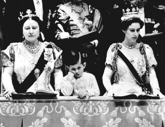 Prince Charles looking solemn as he stands between the Queen Mother and Princess Margaret in the Royal Box at Westminster Abbey, from where he watched the Queen crowned (PA/PA Wire)