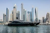 A luxury yacht is pictured off the Dubai Marina Beach on June 10 -- amid coronavirus, some have found time at sea a good way to meet friends