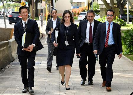 Hawaii Attorney General Douglas Chin arrives at  the U.S. District Court Ninth Circuit to present his arguments  after filing an amended lawsuit against President Donald Trump's new travel ban in Honolulu, Hawaii.