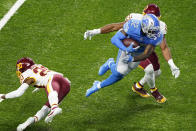 Detroit Lions running back D'Andre Swift (32) avoids a tackle by Washington Football Team cornerback Jimmy Moreland (20) and inside linebacker Jon Bostic (53) before falling into the end zone for a touchdown during the second half of an NFL football game, Sunday, Nov. 15, 2020, in Detroit. (AP Photo/Carlos Osorio)