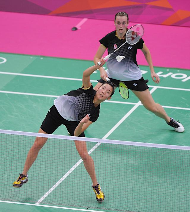 LONDON, ENGLAND - AUGUST 01: Alex Bruce (bottom) and Michelle Li (top) of Canada return against Leanne Choo and Renuga Veeran of Australia in their Women's Doubles Badminton on Day 5 of the London 2012 Olympic Games at Wembley Arena at Wembley Arena on August 1, 2012 in London, England. (Photo by Michael Regan/Getty Images)