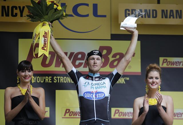Stage winner Italy's Matteo Trentin celebrates on the podium of the seventh stage of the Tour de France cycling race over 234.5 kilometers (145.7 miles) with start in Epernay and finish in Nancy, France, Friday, July 11, 2014. (AP Photo/Christophe Ena)