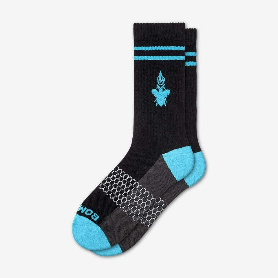 """<p><strong></strong></p><p>bombas.com</p><p><strong>$12.00</strong></p><p><a href=""""https://bombas.com/products/the-men-s-calf-sock-black-blue-medium"""" target=""""_blank"""">Shop Now</a></p><p>With these colorful, comfortable Bombas, giving socks as a gift is anything but boring. </p>"""