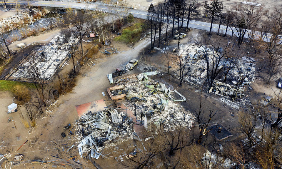 In this photo taken by a drone, homes destroyed by the Mountain View Fire line a street in the Walker community in Mono County, Calif., Wednesday, Nov. 18, 2020. (AP Photo/Noah Berger)