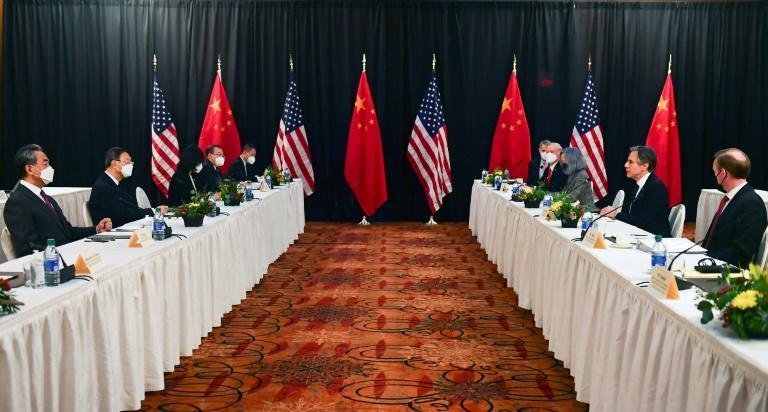 US Secretary of State Antony Blinken (2nd R) speaks while facing top Chinese foreign affairs official Yang Jiechi (2nd L), at the opening session of US-China talks in Anchorage, Alaska on March 18, 2021