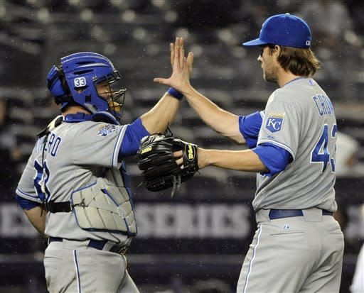Kansas City Royals pitcher Aaron Crow, right, celebrates with catcher Humberto Quintero after the Royals defeated the New York Yankees 6-0 in a baseball game, Monday, May 21, 2012, at Yankee Stadium in New York. (AP Photo/Bill Kostroun)