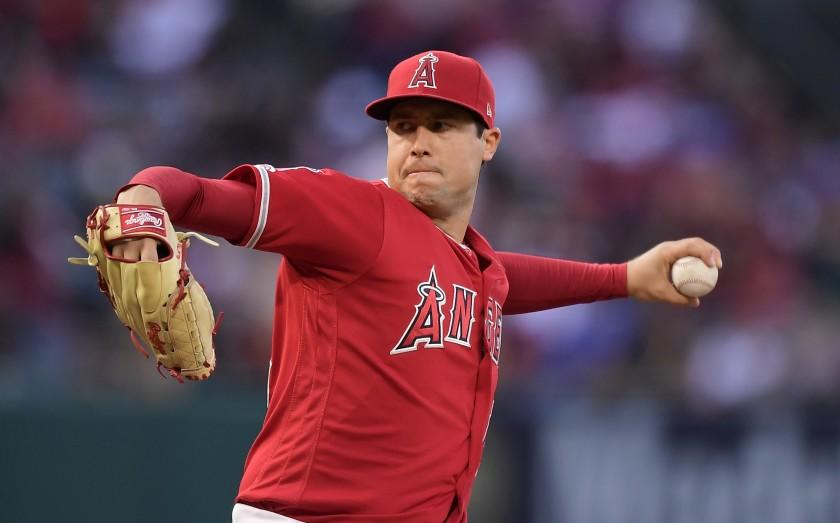 """FILE - In this May 25, 2019, file photo, Los Angeles Angels starting pitcher Tyler Skaggs throws during the first inning of a baseball game against the Texas Rangers in Anaheim, Calif. The Angels say they do not know whether a longtime public relations official had been providing drugs to late pitcher Skaggs, as detailed in a report on ESPN's """"Outside the Lines."""" Eric Kay, a 24-year employee of the Angels' PR department, told the Drug Enforcement Agency he had provided opioids to Skaggs and used them with the pitcher for years, according to the ESPN report Saturday, Oct. 12, 2019. Kay reportedly watched as Skaggs snorted three lines of crushed pills in his hotel room in Texas, on the night before he was found dead. (AP Photo/Mark J. Terrill, File)"""