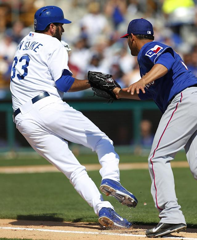 Texas Rangers pitcher Martin Perez, right, tags out Los Angeles Dodgers' Scott Van Slyke on a grounder during the third inning of an exhibition baseball game in Glendale, Ariz., Friday, March 7, 2014. (AP Photo/Paul Sancya)