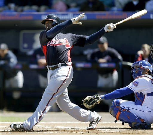 Atlanta Braves outfielder Justin Upton hits a home run off New York Mets relief pitcher Jeremy Hefner during the first inning of an exhibition spring training baseball game, Monday, March 4, 2013, in Port St. Lucie, Fla. (AP Photo/Julio Cortez)