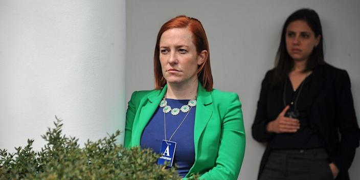 White House Communications Director Jen Psaki listens to US President Barack Obama makes a statement at the White House in Washington, DC, on April 2, 2015 after a deal was reached on Iran's nuclear program.