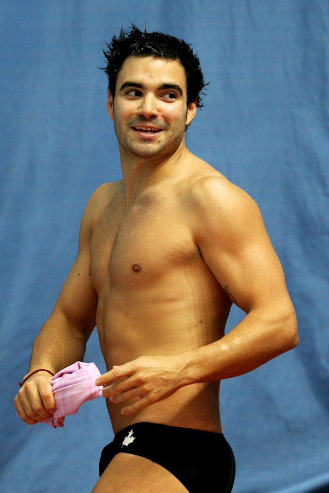 DELHI, INDIA - OCTOBER 11: Alexandre Despatie of Canada celebrates after winning the gold medal in the Men's 3m Springboard Final at Dr. S.P. Mukherjee Aquatics Complex during day eight of the Delhi 2010 Commonwealth Games on October 11, 2010 in Delhi, India. (Photo by Phil Walter/Getty Images)