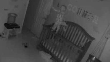 With his head turning from side-to-side, the baby screams for his mother. Photo: YouTube