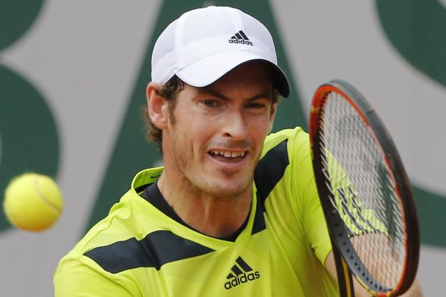 Britain's Andy Murray returns in his second round match of the French Open tennis tournament against Australia's Marinko Matosevic at the Roland Garros stadium, in Paris, France, Thursday, May 29, 2014. Murray won in three sets 6-3, 6-1, 6-3. (AP Photo/Michel Spingler)