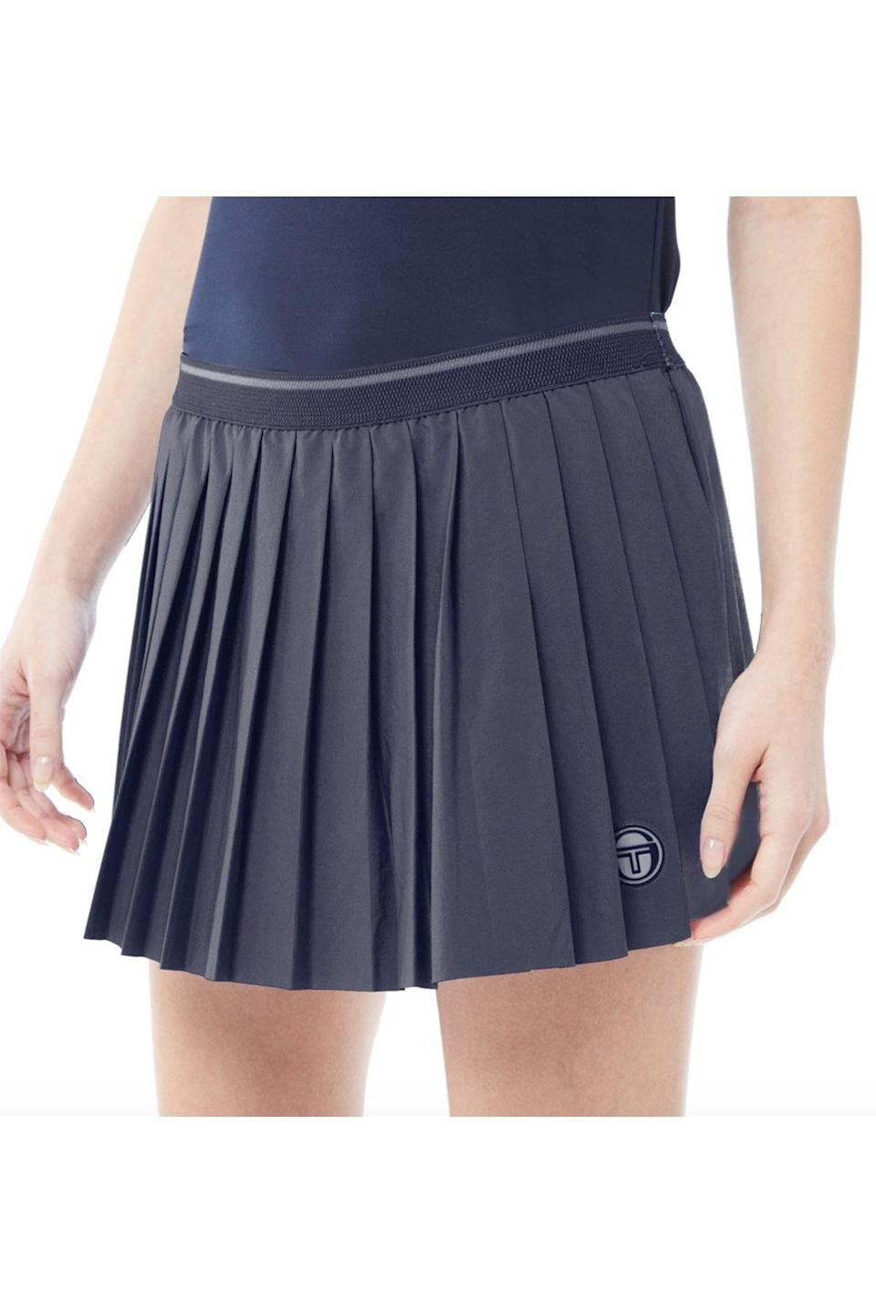 """<p><strong>Sergio Tacchini</strong></p><p>sergiotacchini.com</p><p><strong>$50.00</strong></p><p><a href=""""https://www.sergiotacchini.com/collections/womens-new-arrivals/products/tcp-skort-night-sky-blanc-de-blanc?variant=33084482060342"""" rel=""""nofollow noopener"""" target=""""_blank"""" data-ylk=""""slk:Shop Now"""" class=""""link rapid-noclick-resp"""">Shop Now</a></p><p>Founded by Italian tennis champion Sergio Tacchini in 1966, his namesake brand is known for infusing traditional styles with contemporary flair.</p>"""
