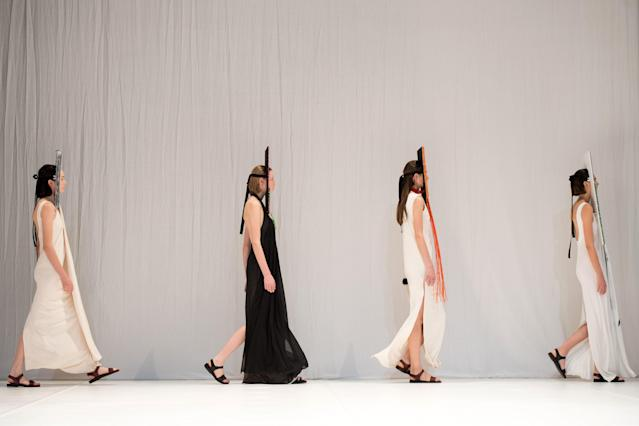The models walking out to take their places.  (CHRIS J RATCLIFFE via Getty Images)