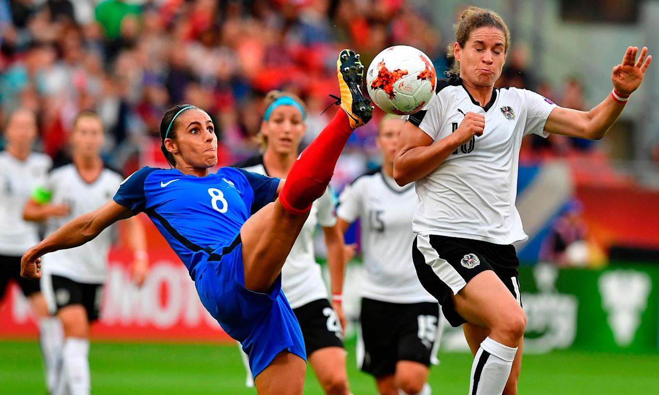 France, whose defender Jessica Houara-D'Hommeaux is stretching here against Austria, must avoid defeat against Switzerland to prevent a shock exit.