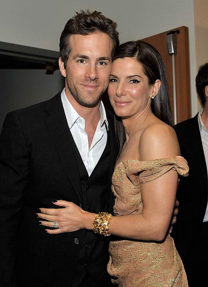 "Ryan Reynolds is going to adopt Sandra Bullock's 19-month-old son Louis, reveals <i>Star</i>. According to the mag, Bullock is already ""blown away with what a great stand-in dad Ryan has become to Louis and how he treats him as his own."" What's more, reports <i>Star</i>, Reynolds is now ""making plans with Sandy for a second adoption."" For details on when the couple will adopt a baby together, as well as the sex of the child, click over to <a href=""http://www.gossipcop.com/ryan-reynolds-adopting-sandra-bullock-baby-louis-adoption-marriage-married/"" target=""new"">Gossip Cop</a>. Charley Gallay/<a href=""http://www.gettyimages.com/"" target=""new"">GettyImages.com</a> - January 6, 2010"