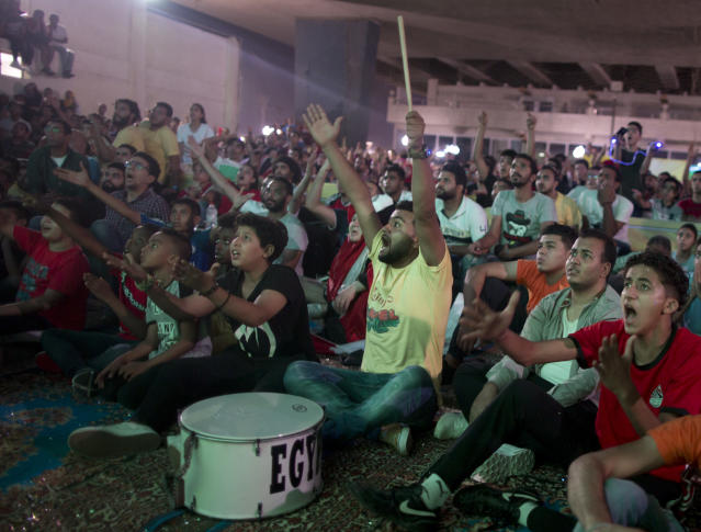 Egyptian fans shout as they watch the group A World Cup match between Egypt and Russia on a screen at Al Jazera youth club, in Cairo, Egypt, Tuesday, June 19, 2018.(AP Photo/Amr Nabil)