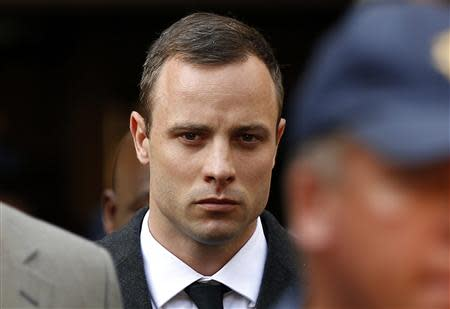 Oscar Pistorius leaves after attending his trial at the high court in Pretoria April 7, 2014. REUTERS/Siphiwe Sibeko