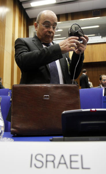 Israel's Ambassador to the International Atomic Energy Agency, IAEA, Ehud Azoulay prepares his equipment prior to the start of the IAEA board of governors meeting at the International Center, in Vienna, Austria, on Tuesday, March 6, 2012. (AP Photo/Ronald Zak)