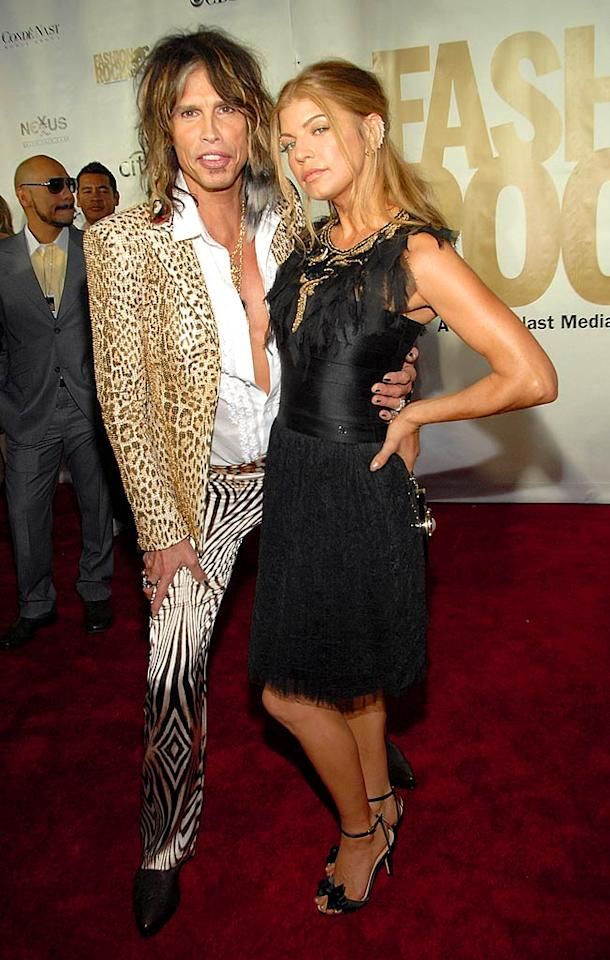 "Wild thing! Steven Tyler rocks an animal print suit, while Fergie opts for a demure frilly black dress. Kevin Mazur/<a href=""http://www.wireimage.com"" target=""new"">WireImage.com</a> - September 6, 2007"