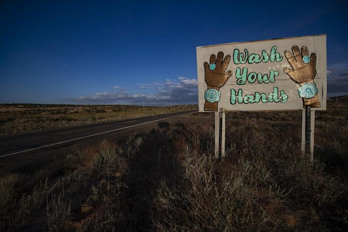 "A sign on Highway 98 featuring Navajo turquoise jewelry reads ""Wash Your Hands"""