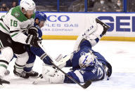 Tampa Bay Lightning goaltender Curtis McElhinney (35) makes a save on a shot from Dallas Stars center Joe Pavelski (16) during the third period of an NHL hockey game Friday, May 7, 2021, in Tampa, Fla. (AP Photo/Jason Behnken)