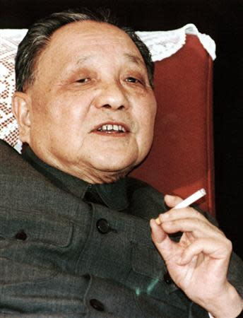 China's leader Deng Xiaoping smokes one of his favourite Panda brand cigarettes in this 1986 file photo taken in Beijing. REUTERS/Stringer/Files