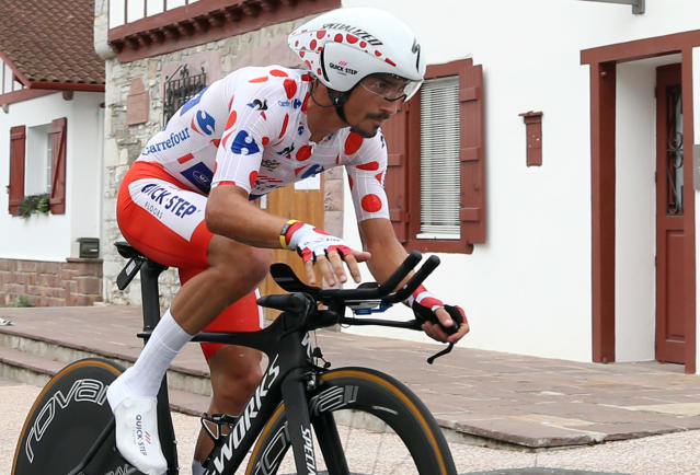 France's Julian Alaphilippe, wearing the best climber's dotted jersey rides during the twentieth stage of the Tour de France cycling race, an individual time trial over 31 kilometers (19.3 miles) with start in Saint-Pee-sur-Nivelle and finish in Espelette, France, Saturday, July 28, 2018. (AP Photo/Bob Edme)
