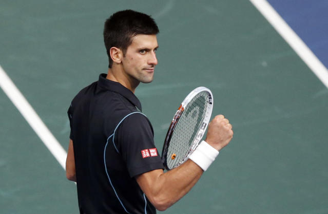 Novak Djokovic of Serbia reacts on the match point after defeating David Ferrer of Spain during their final match, at the Paris Masters tennis at Bercy Arena in Paris, France, Sunday, Nov. 3, 2013. (AP Photo / Francois Mori)
