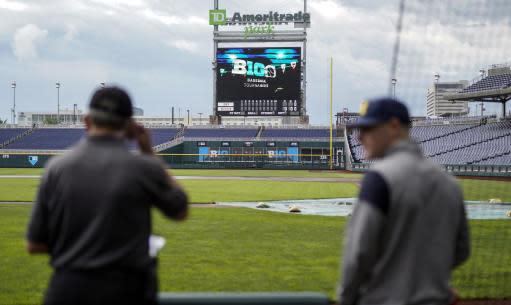 A tarp covers the pitcher's mound on a rainy day in Omaha, Neb., Tuesday, May 22, 2018, ahead of the Big Ten NCAA college baseball tournament. Minnesota is the top seed, Purdue is red hot, and defending champion Iowa is looking to get to the title game for the third straight year. The Big Ten Tournament looks to be wide open as it returns to TD Ameritrade Park for the third time since 2014. (AP Photo/Nati Harnik)