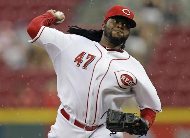 Cincinnati Reds starting pitcher Johnny Cueto throws against the Chicago Cubs in the first inning of a baseball game, Tuesday, Aug. 26, 2014, in Cincinnati. (AP Photo/Al Behrman)