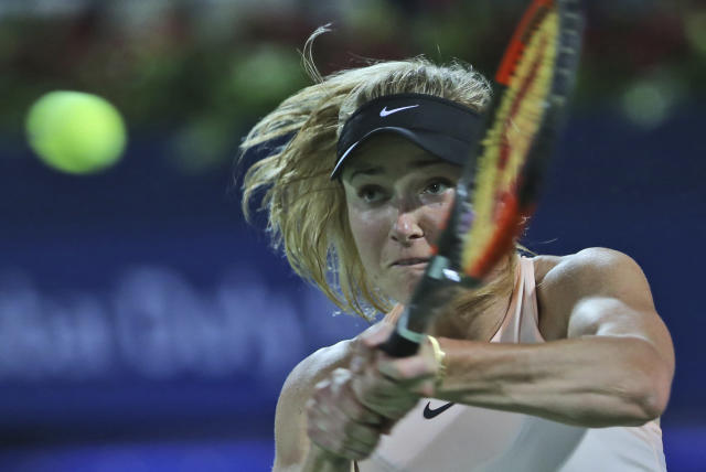 Elina Svitolina of Ukraine returns the ball to Angelique Kerber of Germany during a semi final match of the Dubai Duty Free Tennis Championship in Dubai, United Arab Emirates, Friday, Feb. 23, 2018. (AP Photo/Kamran Jebreili)