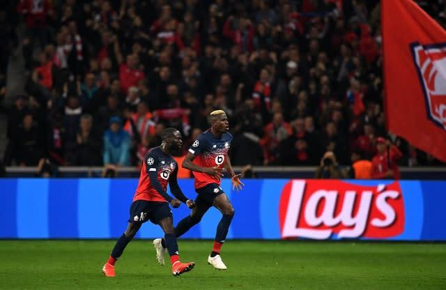 Lille's Victor Osimhen, centre, is fancied to be heading Merseyside (Joe Giddens/PA)