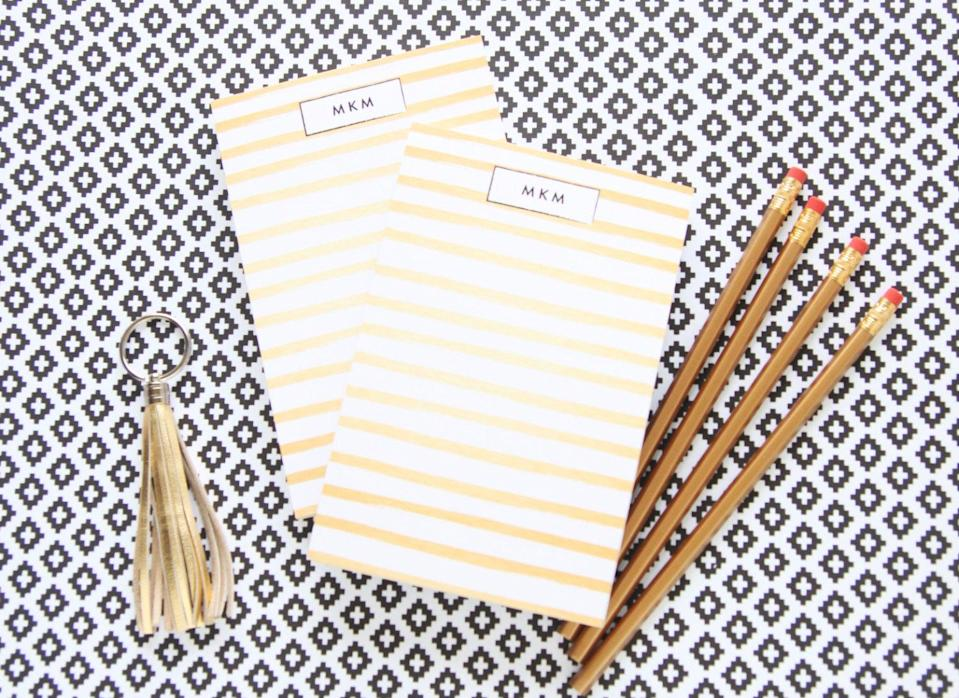 """Gold Tone Signature Stripes Monogrammed Notepad; $16 at <a href=""""https://www.etsy.com/listing/103247311/gold-tone-signature-stripes-monogrammed?ref=sr_gallery_25&ga_search_query=notepad&ga_search_type=all&ga_view_type=gallery"""" rel=""""nofollow noopener"""" target=""""_blank"""" data-ylk=""""slk:etsy.com"""" class=""""link rapid-noclick-resp""""><em>etsy.com</em></a>"""