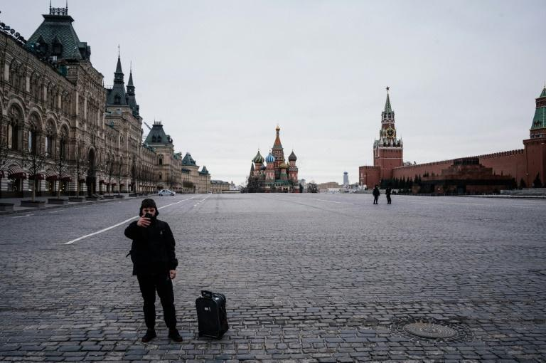 Moscow's Red Square was virtually empty as the lockdown in the city came into force Monday (AFP Photo/Dimitar DILKOFF)