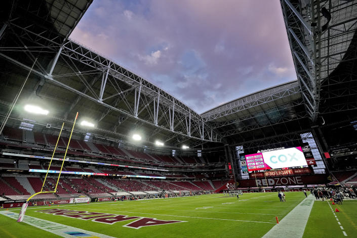 FILE - In this Sunday, Oct. 25, 2020, file photo, the Seattle Seahawks and the Arizona Cardinals compete during the first half of an NFL football game in Glendale, Ariz. The San Francisco 49ers are set to embark on an unusual three-week road trip after being kicked out of their stadium and practice facility because of strict new COVID-19 protocols in their home county in Northern California. The Niners will fly to Arizona, where they will practice, live and play their next two games after Santa Clara County imposed a three-week ban on games and practices for contact sports. (AP Photo/Ross D. Franklin, File)