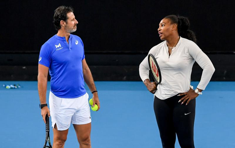 Serena Williams (pictured right) and coach Patrick Mouratoglou (pictured left) chat during a practice session.