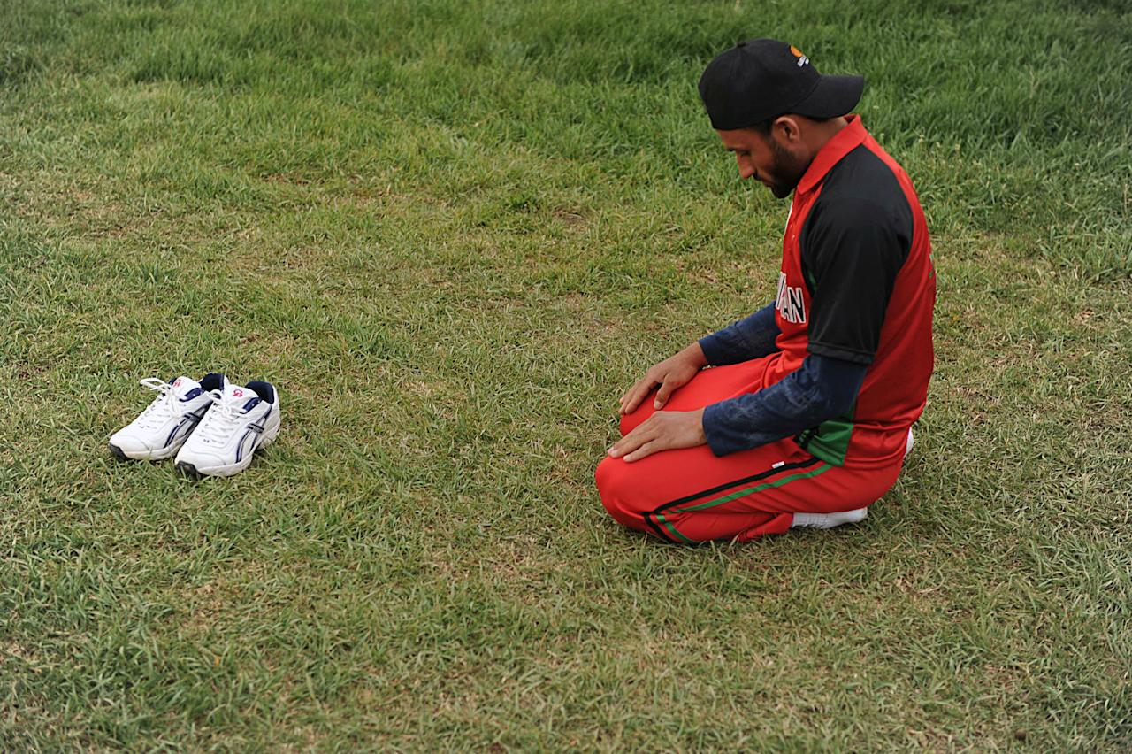 To go with story Afghanistan-unrest-disabled-cricket,FOCUS by Phil Hazlewood   A cricker team member of a disabled Afghan cricket team, mainly made up of landmine victims, prays before playing against international sides composed of diplomatic staff in Kabul on April 3, 2010. The players participated in a tournament designed to raise awareness of the threat still posed by landmines and unexploded ordnance in Afghanistan ahead of International Day for Mines Awareness on Sunday. AFP PHOTO/SHAH Marai (Photo credit should read SHAH MARAI/AFP/Getty Images)