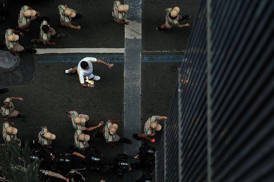 The Olympic flame is paraded through Rio de Janeiro on Wednesday. (Yasuyoshi Chiba/Getty Images)