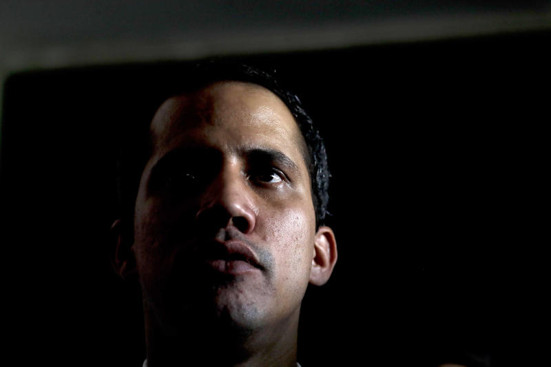 Venezuela's self-proclaimed interim president Juan Guaido attends a meeting with electricity experts in Caracas, Venezuela, Thursday, March 28, 2019. The Venezuelan government on Thursday said it has barred Guaido from holding public office for 15 years, though the National Assembly leader responded soon afterward that he would continue his campaign to oust President Nicolas Maduro. (AP Photo/Natacha Pisarenko)