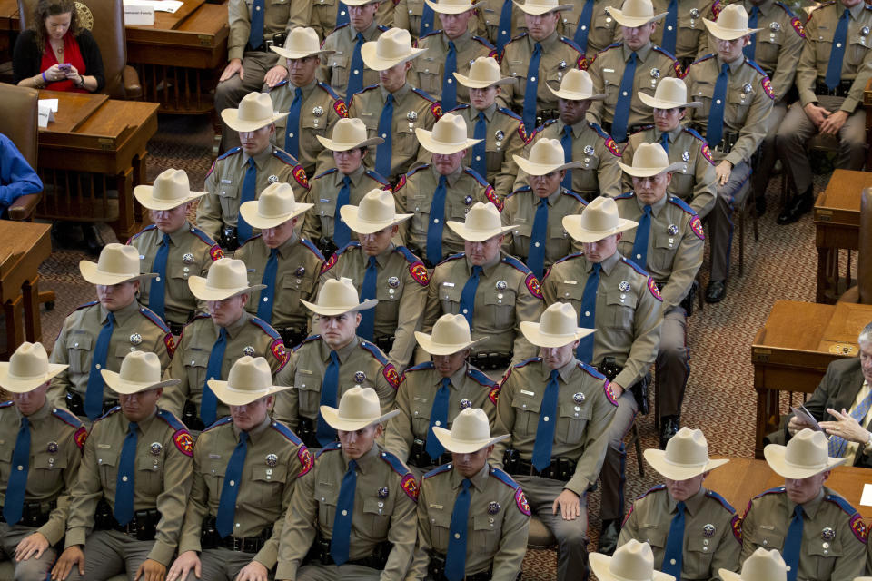 Texas Department of Public Safety (DPS) commissions a class of 74 new state troopers at the Texas Capitol following 21 weeks of training in counter-terrorism, traffic and criminal law and arrest procedures. (Photo by Robert Daemmrich Photography Inc/Corbis via Getty Images)