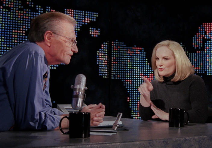 """FILE - In this Jan. 31, 2001 file photo, Patricia Hearst Shaw gestures toward talk show host Larry King on the set of CNN's """"Larry King Live,"""" in New York. King, who interviewed presidents, movie stars and ordinary Joes during a half-century in broadcasting, has died at age 87. Ora Media, the studio and network he co-founded, tweeted that King died Saturday, Jan. 23, 2021 morning at Cedars-Sinai Medical Center in Los Angeles. (AP Photo/Tina Fineberg, File)"""