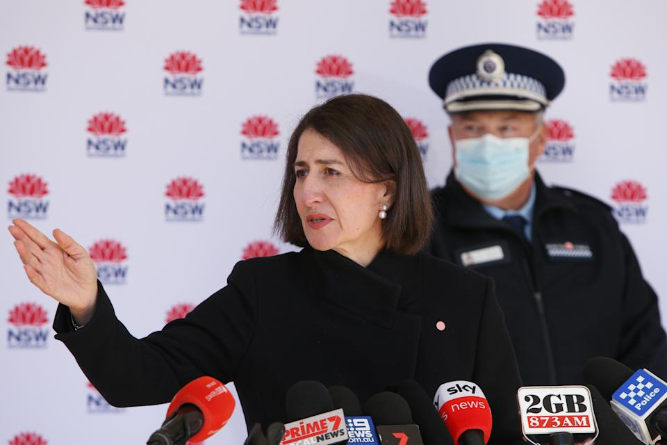 SYDNEY, AUSTRALIA - JULY 07: Premier Gladys Berejiklian takes questions during a COVID-19 update and press conference on July 07, 2021 in Sydney, Australia. Lockdown restrictions have been extended by another week across Greater Sydney, the Blue Mountains, the Central Coast and Wollongong as NSW health authorities work to contain a growing COVID-19 cluster. Restrictions will remain in place until midnight on Friday 16 July. All residents in areas subject to stay-at-home orders are only permitted to leave their homes for essential reasons, including purchasing essential goods, accessing or providing care/healthcare, work, education and exercise. Students in greater Sydney will not return to face-to-face classes when holidays end next Tuesday and will begin the new term with online classes. Regional schools will reopen for face-to-face learning as planned on 13 July for term three. (Photo by Lisa Maree Williams/Getty Images)