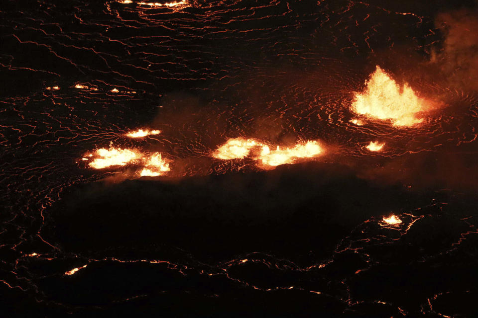 This photo provided by USGS, shows the eruption within in Kilauea volcano's Halemaumau crater at the volcano's summit on Wednesday, Sept. 29, 2021. One of the most active volcanos on Earth is erupting on Hawaii's Big Island. (M. Patrick /USGS via AP)
